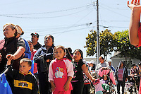 Hebbron residents wait in line for food distributed once a week at St. Clare's Corner, established in Salinas by the Franciscan Workers of Junipero Serra in 1982. Supplied by the Food Bank of Monterey County, basic foodstuffs like rice and beans supplement family diets from October to May, the winter months when unemployment is highest.
