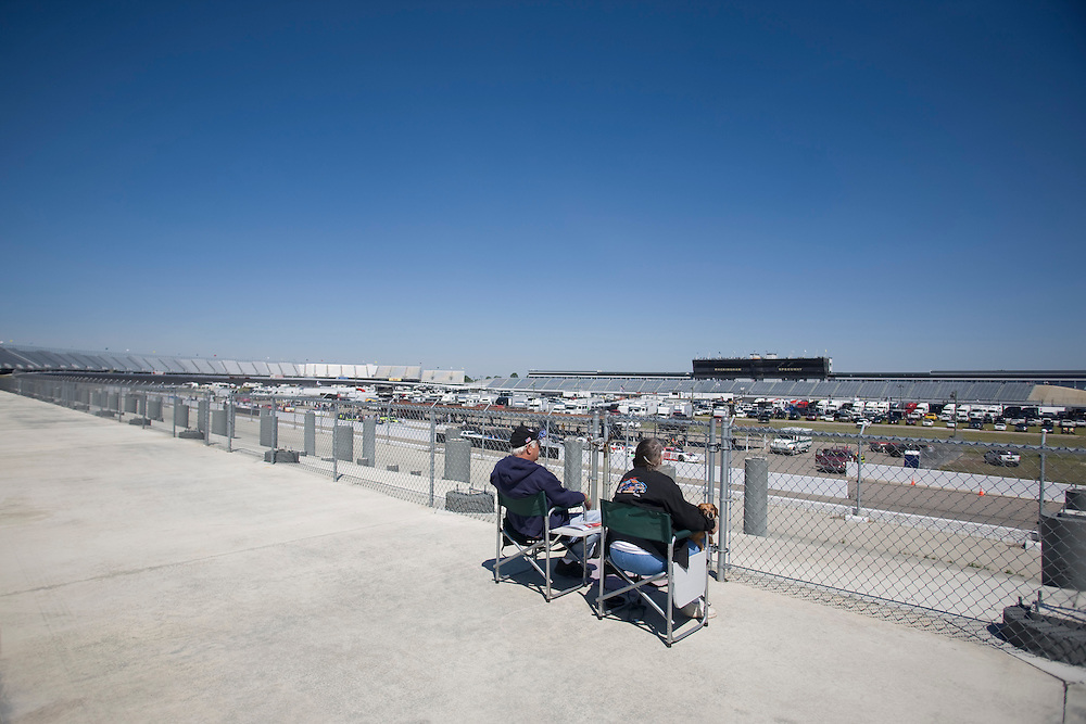 Race fans from Michigan sit were massive grandstands once stood, removed after NASCAR pulled out of Rockingham Speedway.