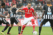 Nacional´s player Sequeira (L ) fights for the ball with Benfica's player Mitroglou   (C) during Portuguese First League football match Nacional vs Benfica  held at Madeira Stadium, Funchal, 11 January 2016.  LUSA / GREGORIO CUNHA