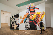 A retrospective of Pop-art pioneer Richard Hamilton opens at the Tate this week. He was widely regarded as the founding figure of Pop art, and this exhibition presents over 60 years of work from 1950s installations to his final paintings of 2011. Major works include: Fun House  (pictured) – An immersive Pop installation featuring a jukebox and blown-up images from Hollywood movies, science-fiction and advertising;  Swingeing London – An iconic image of Mick Jagger following his arrest on drugs charges in 1967; and his final work – A triptych of computer-aided images printed onto canvas, inspired by the Italian Renaissance masters. Tate Modern, London, UK 11 Feb 2014.