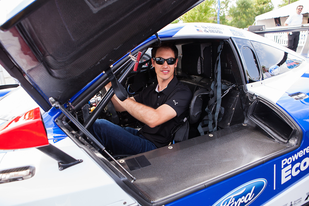 Joey Logano sits inside a Ford GT at a Ford Performance event.  Photographed for Ford Performance by KMS Photography