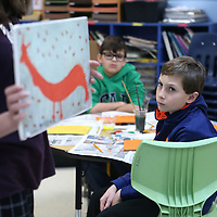 Adam Robison | BUY AT PHOTOS.DJOURNAL.COM<br /> Mason Wise, a fifth grader at Saltillo Elementary School, listens as Emily McCauley, Curator of Education, at the University of Mississippi Museum, as she holds a piece of art work by Folk Artitst Mose Tolliver Tuesday morning in Saltillo. The students learned about Folk Art as part of the Traveling Trunk Show with the University of Mississippi Museum.