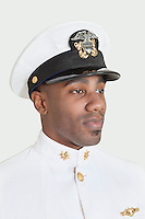 Young African American US Navy officer over gray background