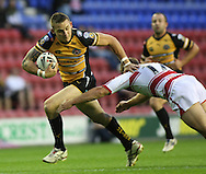 Wigan - Sunday 20th September 2009: Richard Owen of the Castleford Tigers is tackled by Michael Mcilorum of the Wigan Warriors during the Engage Super League Elimination Playoff match between The Wigan Warriors & The Castleford Tigers at the DW Stadium in Wigan. (Pic by Steven Price/Focus Images)