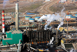 CANADA ALBERTA FORT MCMURRAY 10MAY07 - Aerial view of Suncor upgrader plant north of Fort McMurray, Alberta, Canada. The Alberta Tar Sands are the largest deposits of their kind in the world and their production is the single largest contributor to Canada's greenhouse gas emissions...Alberta's tar sands are currently estimated to contain a crude bitumen resource of 315 billion barrels, with remaining established reserves of almost 174 billion barrels, thus making Canada's oil resources ranked second largest in the world in terms of size...The industry has brought wealth and an economic boom to the region but also created an environmental disaster downstream from the Athabasca river, polluting the lakes where water and fish are contaminated. The native Indian tribes of the Mikisew, Cree, Dene and other smaller First Nations are seeing their natural habitat destroyed and are largely powerless to stop or slow down the rapid expansion of the oil sands development, Canada's number one economic driver...jre/Photo by Jiri Rezac / WWF-UK..© Jiri Rezac 2007..Contact: +44 (0) 7050 110 417.Mobile: +44 (0) 7801 337 683.Office: +44 (0) 20 8968 9635..Email: jiri@jirirezac.com.Web: www.jirirezac.com..© All images Jiri Rezac 2007 - All rights reserved.