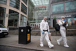 © Licensed to London News Pictures. 11/10/2019. Manchester, UK. Forensic scenes of crime examiners in front of the entrance to the Arndale Centre . Terrorism Police are investigating after four people were stabbed during a single attack at the Arndale Centre in Manchester City Centre . Photo credit: Joel Goodman/LNP