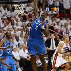 Jun 17, 2012; Miam, FL, USA; Oklahoma City Thunder center Kendrick Perkins (5) rebounds against the Miami Heat during the second half in game three in the 2012 NBA Finals at the American Airlines Arena. Miami won 91-85. Mandatory Credit: Derick E. Hingle-US PRESSWIRE