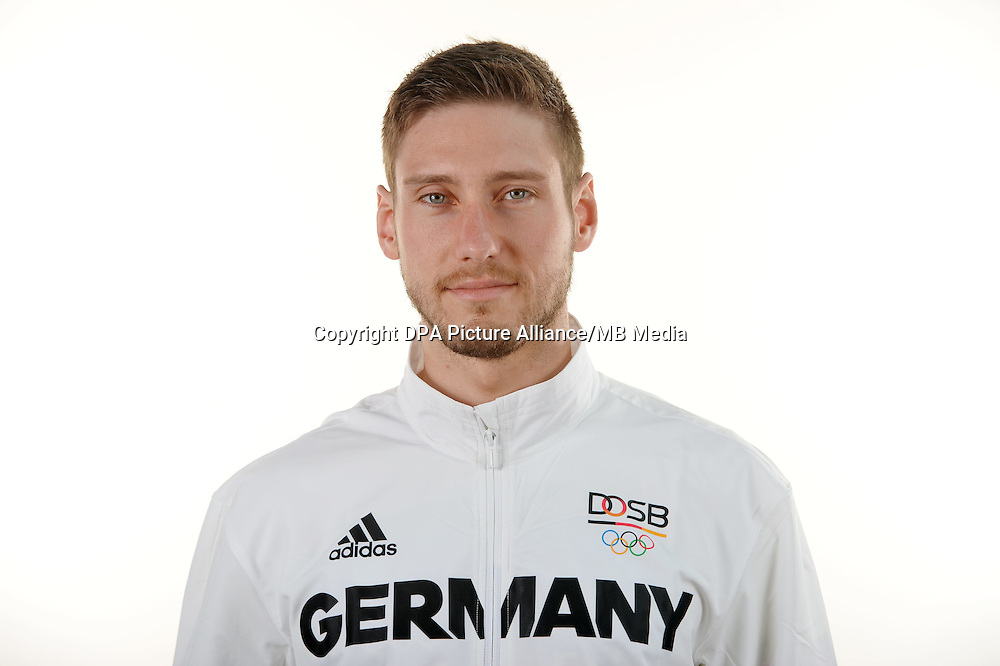 Maximilian Hartung poses at a photocall during the preparations for the Olympic Games in Rio at the Emmich Cambrai Barracks in Hanover, Germany. July 06, 2016. Photo credit: Frank May/ picture alliance. | usage worldwide