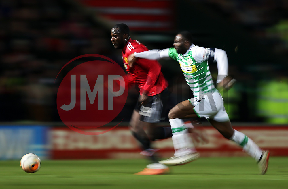 Romelu Lukaku of Manchester United takes on Francois Zoko of Yeovil Town- Rogan/JMP - 26/01/2018 - FOOTBALL - Huish Park - Yeovil, England - Yeovil Town v Manchester United - FA Cup Fourth Round.