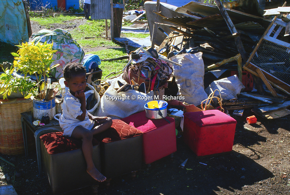 A child sits among possessions left outside her damaged home In September 1988 after Hurricane Gilbert hit Jamaica. By the time the destruction had stopped, 45 people were dead and over 500,000 left homeless. Agriculture was devastated, with US$50 million in damage to coffee, sugar cane, banana and other crops. Looting was widespread, particularly in Kingston. Foreign aid of about US$125 million form the USA alone poured into the stricken island. The tourist parts of the island were returned to normal with remarkable speed, but others took much longer to recover from the devastation.