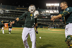 OAKLAND, CA - JULY 19:  Josh Reddick #22 of the Oakland Athletics is hit in the face with a cream pie by Stephen Vogt #21 after hitting a walk off single against the Houston Astros during the tenth inning at the Oakland Coliseum on July 19, 2016 in Oakland, California. The Oakland Athletics defeated the Houston Astros 4-3 in 10 innings. (Photo by Jason O. Watson/Getty Images) *** Local Caption *** Josh Reddick; Stephen Vogt