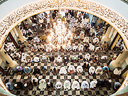 19 JUNE 2015 - PATTANI, PATTANI, THAILAND: Friday midday prayers in Pattani Central Mosque. Pattani Central Mosque is the main mosque in Pattani and was built in 1963. It is especially crowded during Ramadan, when the crowd frequently spills out into the street.     PHOTO BY JACK KURTZ
