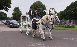 A white horse-drawn hearse carrying the coffin of Kelly Brewster, who died in the Manchester Arena terror attack, arrives at City Road Cemetery in Sheffield for her funeral.
