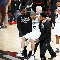 03 May 2017: San Antonio Spurs guard Tony Parker (9) is helped out of the court during the San Antonio Spurs 121-96 victory over the Houston Rockets, in game 2 of the Western Conference Semi Finals, at the AT&T Center, San Antonio, Texas, USA.
