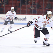 Zach Aston-Reese #12 of the Northeastern Huskies skates on the ice during the game at Matthews Arena on January 18, 2014 in Boston, Massachusetts. (Photo by Elan Kawesch)
