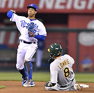 April 13, 2017 - Kansas City, MO, USA - Kansas City Royals second baseman Raul Mondesi forces out the Oakland Athletics' Jed Lowrie (8) at second and completes the double play to end the top of the fourth inning at Kauffman Stadium in Kansas City, Mo., on Thursday, April 13, 2017. (Credit Image: © John Sleezer/TNS via ZUMA Wire)