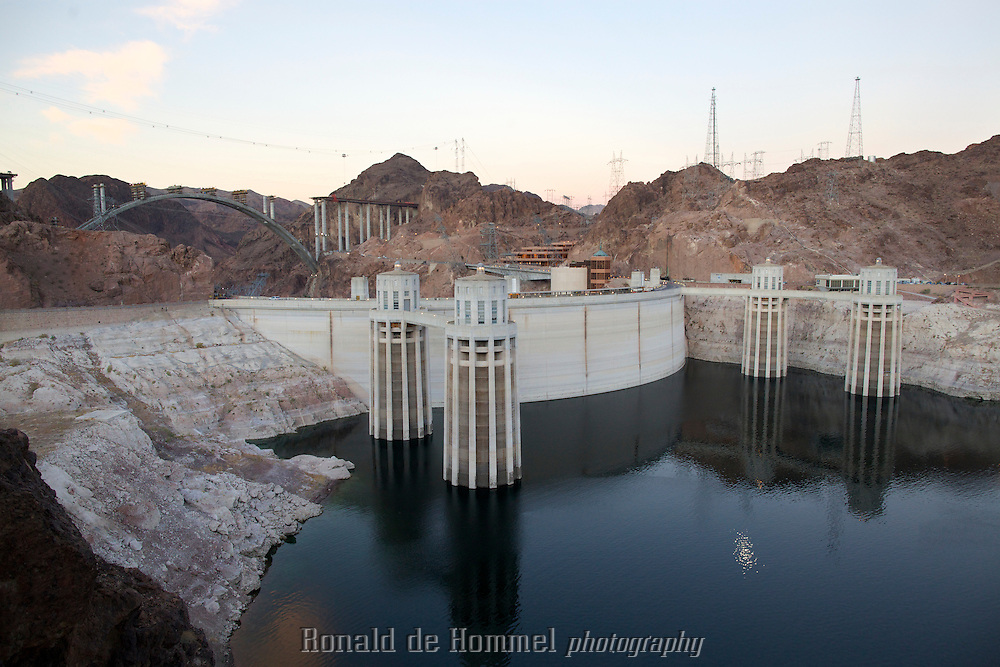 The back side of the Hoover Dam, the most famous dam in the US. Because of a ten year drought in the south west, the level of Lake Mead has gone down more than 50 feet (17m). Currently the lake is at approximately 50 percent of it's capacity. A big danger for cities like Las Vegas that rely on its water. Due to climate change this level could drop even more. 7 States in the US and two in Mexico rely on the water of the Colorado River.
