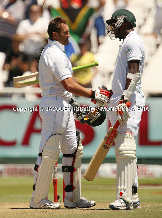 Jacques Kallis is congratulated by Lonwabo Tsotsobe for reaching 150 runs during Day 2 of the third and final Test between South Africa and India played at Sahara Park Newlands in Cape Town, South Africa, on 2 January 2011. Photo by Jacques Rossouw / MONSOON MEDIA