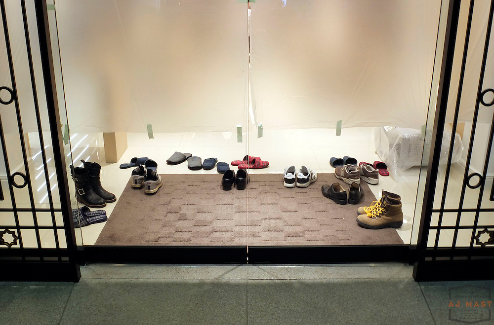 Department store workers shoes after hours in Tokyo Japan Friday, Nov. 21, 2011.