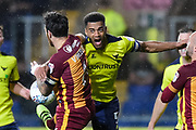 Bradford City midfielder Romain Vincelot (6) and Oxford United defender Curtis Nelson (5) battle for the ball during the EFL Sky Bet League 1 match between Oxford United and Bradford City at the Kassam Stadium, Oxford, England on 12 September 2017. Photo by Dennis Goodwin.
