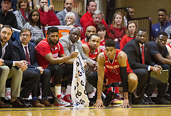 Feb 18, 2017; Morgantown, WV, USA; Texas Tech Red Raiders forward Justin Gray (5) kneels along the bench during the first half against the West Virginia Mountaineers at WVU Coliseum. Mandatory Credit: Ben Queen-USA TODAY Sports