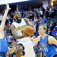 06 March 2016: Denver Nuggets guard JaKarr Sampson (9) goes for the layup past Dallas Mavericks forward Chandler Parsons (25) and Dallas Mavericks forward Dirk Nowitzki (41) during the Denver Nuggets 116-114 overtime victory over the Dallas Mavericks, at the Pepsi Center, Denver, Colorado, USA.