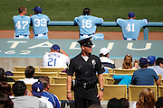 LOS ANGELES, CA - APRIL  21:  A policeman looks on during the game between the Atlanta Braves and the Los Angeles Dodgers on Thursday, April 21, 2011 at Dodger Stadium in Los Angeles, California. The Dodgers won the game 5-3 in 12 innings. (Photo by Paul Spinelli/MLB Photos via Getty Images)