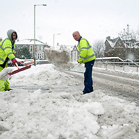 Snow and Ice In Perthshire....30.11.10<br /> Perth & Kinross council workers trying to clear the build up of snow and ice on Glenearn Road in Perth, as snow continues to fall<br /> Picture by Graeme Hart.<br /> Copyright Perthshire Picture Agency<br /> Tel: 01738 623350  Mobile: 07990 594431