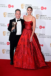Suranne Jones presents Tom Hollander with the award for Best in the press room at the Virgin TV British Academy Television Awards 2017 held at Festival Hall at Southbank Centre, London. PRESS ASSOCIATION Photo. Picture date: Sunday May 14, 2017. See PA story SHOWBIZ Bafta. Photo credit should read: Ian West/PA Wire