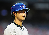 PHOENIX, AZ - MAY 27:  Pitcher Yu Darvish #11 of the Texas Rangers walks back to the dugout after striking out in the interleague game against the Arizona Diamondbacks in the seventh inning at Chase Field on May 27, 2013 in Phoenix, Arizona.  (Photo by Jennifer Stewart/Getty Images) *** Local Caption *** Yu Darvish