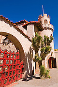 Red gate and tower at Scottys Castle, Death Valley National Park. California USA