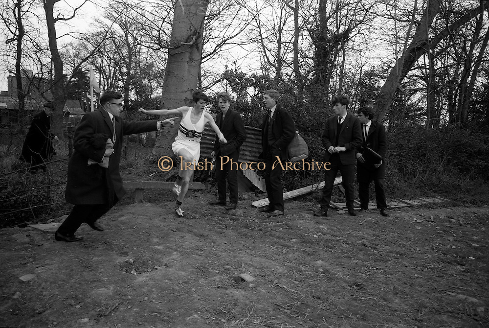23/03/1966<br /> 03/23/1966<br /> 23 March 1966<br /> All Ireland Colleges Cross Country Championships held at Belfield, Dublin. Finger Whyte, Colaiste Christ Ri, Cork, cheered through the last gap as he comes into the straight to win the All Ireland Colleges Intermediate Championship Cross Country race.