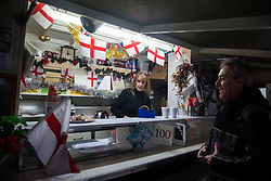 London, UK. 20 December, 2019. Cheryl Diamond serves Dave Conway, the very last customer of Syd's Coffee Stall, which has been run by three generations of the same family on the corner of Shoreditch High Street and Calvert Avenue since 1919. The mahogany coffee stall, part of east London's history, will go on display in the new Museum of London in Smithfield in 2024.
