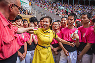 Chinese journalist jokes with man of Colla Vella Xiquets de Valls.'Castellers' building human tower, a Catalan tradition.Biannual contest. bullring.Tarragona, catalonia,Spain