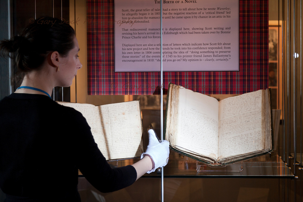 The original manuscript of Sir Walter Scott's 'Waverley' - fiction's first global bestseller - goes on display today at the National Library of Scotland in Edinburgh. Ciara McDermott,<br /> Exhibitions Assistant, has a close look at the 200 year-old manuscript. 10th September 2014. &copy; Gary Doak Photography