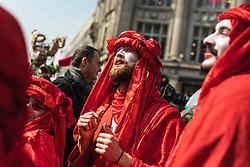 © Licensed to London News Pictures. 15/04/2019. London, UK. Environmental activists from the Extinction Rebellion movement in costume as they march down Regent Street during a series of direct actions taking place across the capital. The protests demand urgent action from governments on climate change. Photo credit: Rob Pinney/LNP