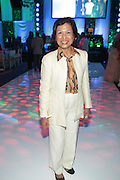 Water Mill, New York:  Loida Lewis, Chair and CEO of TLC Beatrice International attends the RUSH Philanthropic Arts Foundation 15th Annual Art For Life Benefit Gala held in the Hamptons at the Farmview Farms on July 26, 2014  in Water Mill, New York. (Terrence Jennings)
