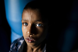 May 5, 2019 - Dhaka, Bangladesh - A rare blue eyed boy, who is deaf by birth poses for a photo beside a plastic drum warehouse at Dhaka, Bangladesh on April 5, 2019. (Credit Image: © Ziaul Haque/NurPhoto via ZUMA Press)