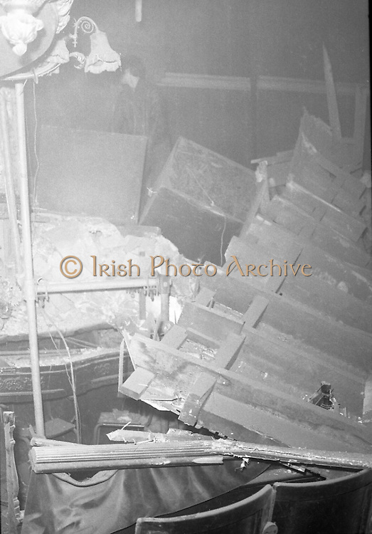 "Stage at The Olympia Theatre Collapses..05.11.1974..11.05 1974..5th November 1974..At the lunch-time break during rehearsals for the musical West Side Story the front section of the Olympia stage collapsed. Fire brigades rushed to the scene in case of casualties. The theatre will remain closed until further notice until structural examinations of the building are carried out by the relevant authorities..Image shows the devastation caused when a section of the Olympia stage collapsed during a break in rehearsals for ""West Side Story""."