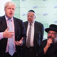 London, UK - 7 August 2014: The Mayor Boris Johnson visits Rabbi Oscher Schapiro (R) and the Orthodox Jewish community in Stamford Hill, London
