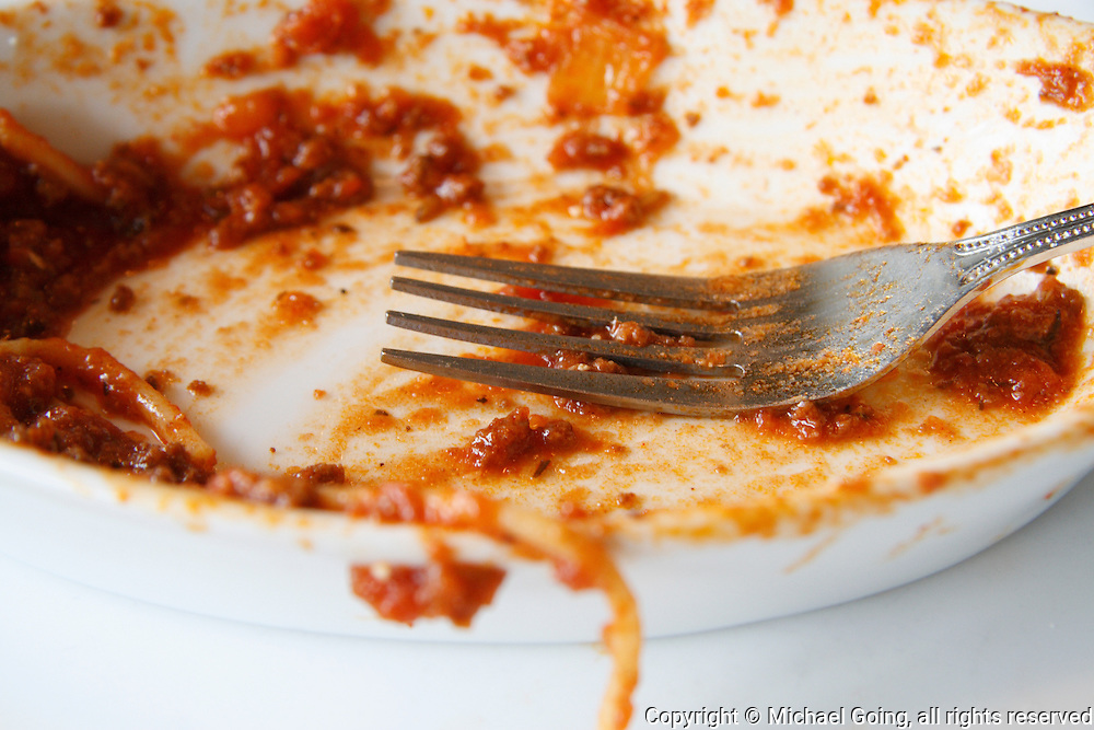 Left over meal of spaghetti with a fork
