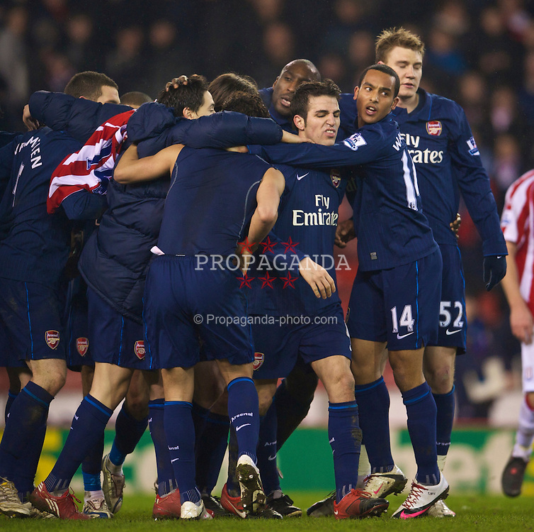 STOKE-ON-TRENT, ENGLAND - Saturday, February 27, 2010: Arsenal's Cesc Fabregas leads his team's celebrations after beating Stoke City 3-1 during the FA Premier League match at the Britannia Stadium. (Photo by David Rawcliffe/Propaganda)