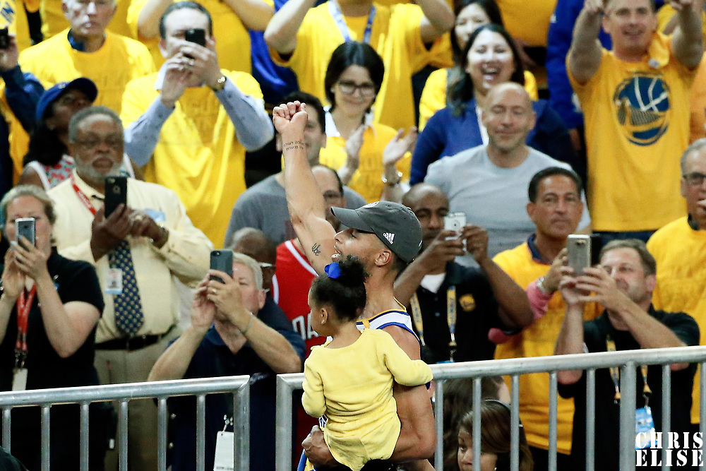 12 June 2017: Golden State Warriors guard Stephen Curry (30) celebrates with his daughter during the Golden State Warriors 129-120 victory over the Cleveland Cavaliers, in game 5 of the 2017 NBA Finals, at the Oracle Arena, Oakland, California, USA.