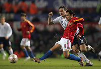 Photo: Paul Thomas.<br /> England v Spain. International Friendly. 07/02/2007.<br /> <br /> Xavier Hernandez (Red) of Spain passes it in front of Frank Lampard.
