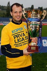 Sasa Bozicic of Koper celebrates with a Trophy  after the football match between NK Nafta Lendava and NK Luka Koper of PrvaLiga league on May 16, 2010 in Lendava, Slovenia. Nafta lost 1 : 2, Koper became National champion.  (Photo by Urban Urbanc / Sportida)