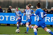 Brighton's Amy Green runs with the ball during the FA Women's Premier League match between Brighton Ladies and Cardiff City Ladies at Brighton's Training Ground, Lancing, United Kingdom on 22 March 2015. Photo by Geoff Penn.