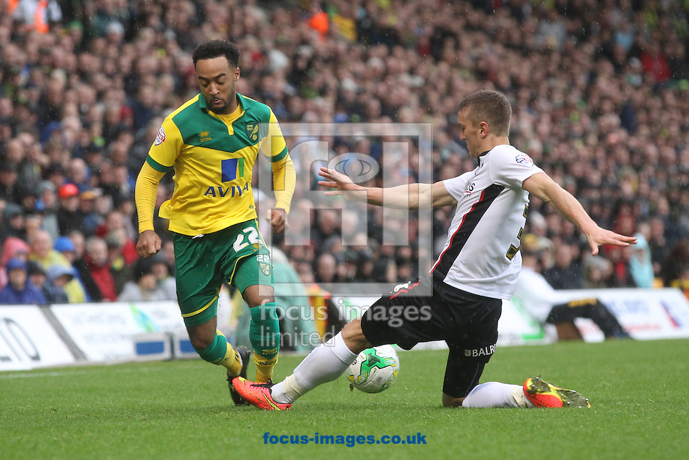 Nathan Redmond of Norwich and Joe Skarz of Rotherham United in action during the Sky Bet Championship match at Carrow Road, Norwich<br /> Picture by Paul Chesterton/Focus Images Ltd +44 7904 640267<br /> 04/10/2014