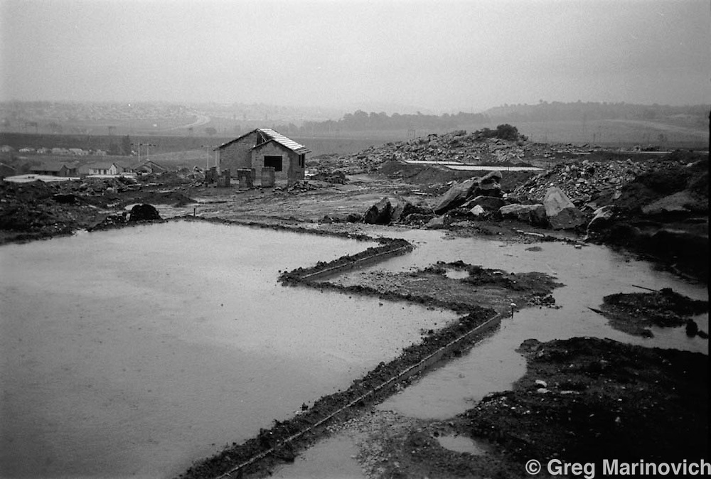 HOUSING SOUTH AFRICA - Nov 1998: Foundations for new housing on a rainy day on the outskirts of Soweto, New Canada. 1998. The South African government's housing policy and subsidies made it possible for poor families to get a low-cost housing unit on land they now own title deed to. (Photo by Greg Marinovich / Getty Images)