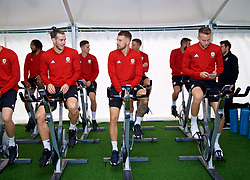 CARDIFF, WALES - Monday, September 3, 2018: Wales' Gareth Bale, Aaron Ramsey and Chris Gunter on warm-up bikes in the pre-activation tent before a training session at the Vale Resort ahead of the UEFA Nations League Group Stage League B Group 4 match between Wales and Republic of Ireland. (Pic by David Rawcliffe/Propaganda)