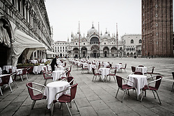 March 10, 2020, Venice, Italy: A waiter walks around an empty restaurant at St. Marcus square. All of Italy is being placed on lockdown due to coronavirus. (Credit Image: © Mirco Toniolo/Ropi via ZUMA Press)